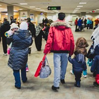 Syrian refugees arrive at the Halifax airport last winter.