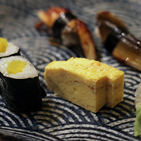 Umeboshi maki, eel nigiri and tamagoyaki.