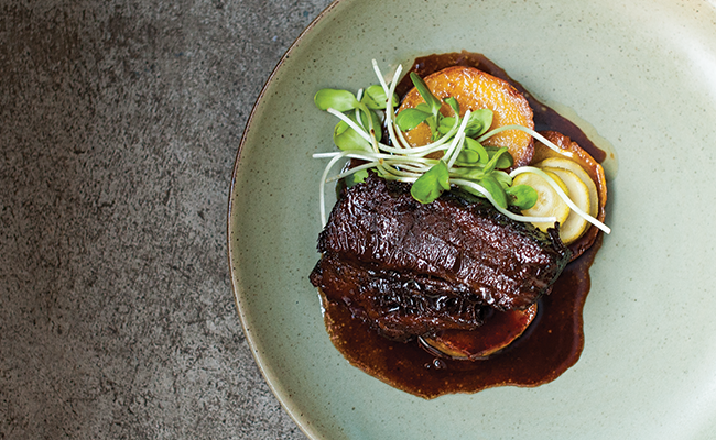 Beer and molasses braised beef brisket with roasted squash and pickles - JESSICA EMIN