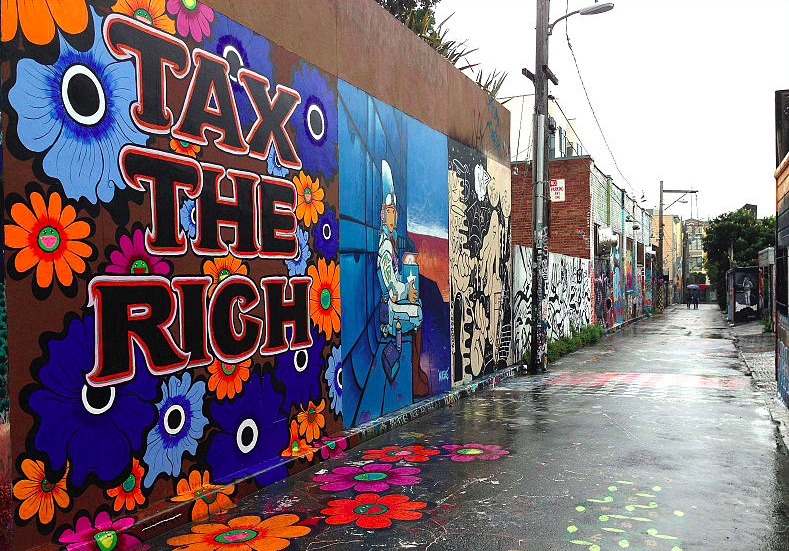 """Tax The Rich"" mural by Megan Wilson on Clarion Alley San Francisco. - VICTORGRIGAS VIA WIKICOMMONS"