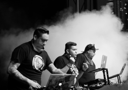 The DJ Collective rings in 2018 at a free, outdoor show. - ATRIBECALLEDRED.COM SCREENSHOT