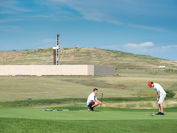 Golfing and drilling in Erie. - TED WOOD / THE STORY GROUP
