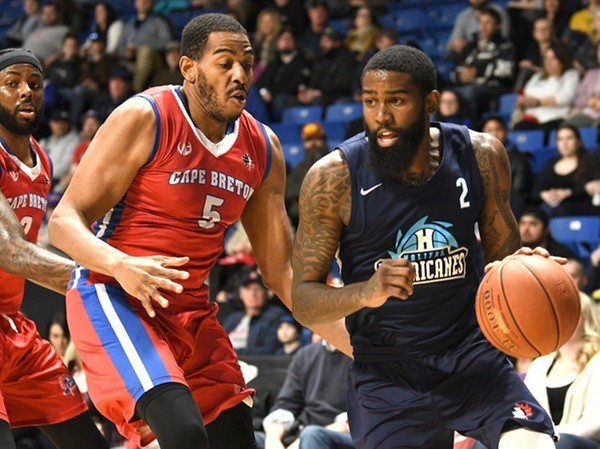 Halifax Hurricanes' Terry Thomas finds an open lane against the Cape Breton Highlanders' Theron Laudermill. Fans driving to Saturday's playoff climax might not be so lucky. - HALIFAX HURRICANES
