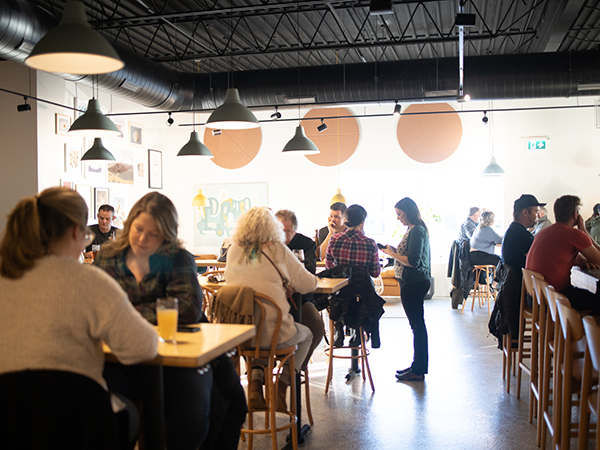 The new North Brewing is a 7,500-square foot industrial space that feels homey, almost cozy. - RILEY SMITH