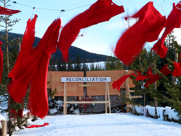 Red dresses hung along the road near the Unist'ot'en healing centre in BC. - AMANDA FOLLETT HOSGOOD