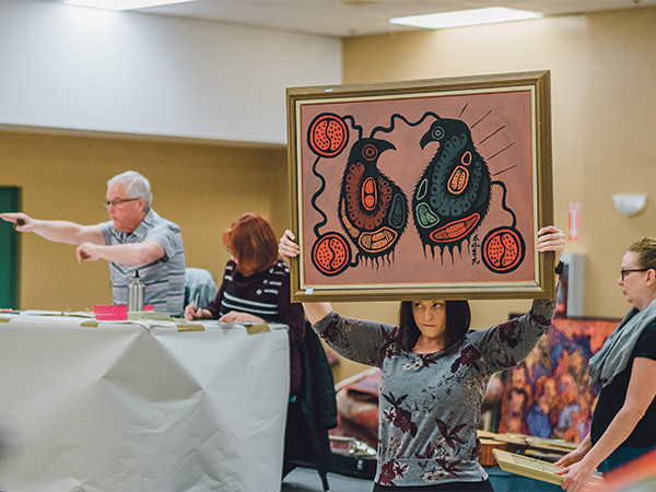 There's a lot to see at an auction, like the one above at the Halifax Forum, so Melanie Mather of Lo + Behold says it's important to stay focused. - IAN SELIG