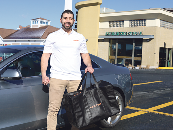 Moh Soliman, co-founder of Couryah delivery service, is seeing a big surge in business during the coronavirus pandemic.