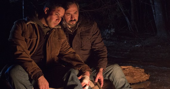 Justin Rain and Glen Gould keep warm in the woods.
