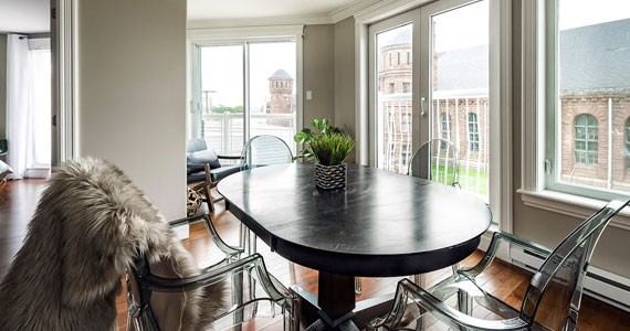 Ghost chairs play a prominent role in this north end condo, designed by Lane - CHRIS J. DICKSON