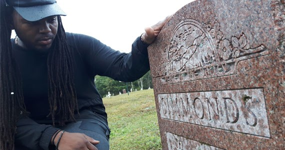 Music producer and filmmaker Keke Beatz pays respects to his grandmother's grave. - FRANCELLA FIALLOS