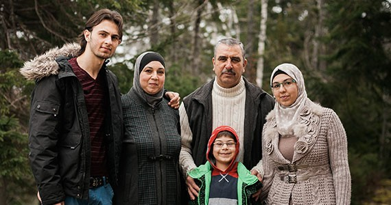 Dana (far right) says one of her favourite moments since coming to Canada was at a potluck soon after arrival. By chance, her family met a woman at the potluck who was from Darayya—the same suburb of Damascus as the Mellis. - She's now become a close friend of the family. - KRISTA COMEAU