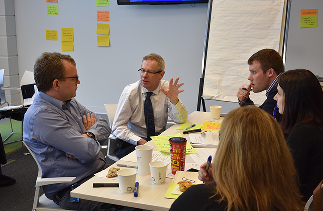 L-R: Councillor Waye Mason, HRM lawyer Martin Ward, commissioner Jeff Mitchell and HRP policy coordinator Kathleen Patterson work out an action plan last week in Dartmouth. - THE COAST