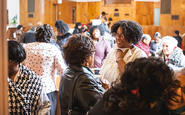 Pastor Britton greets some members of her congregation after Sunday service. - MEGHAN TANSEY WHITTON