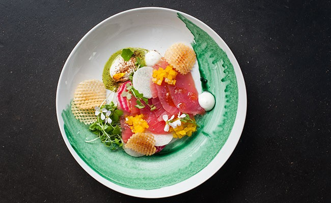 Tuna crudo with pickled yellow beet, jicama, sweet and sour dill, black garlic labneh, cured yolk and gaufrette potato. - JESSICA EMIN
