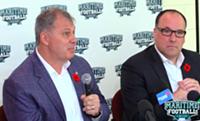 CFL commissioner Randy Ambrosie (left) addresses the media while MFLP partner Anthony LeBlanc watches.