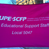 Educational support workers standing with teachers