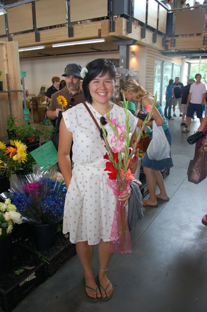 "Vegetables weren't the only thing that was fresh on opening day of the new Halifax Seaport Farmers' Market. Fiona's white and gold-patterned summer dress, a find from Value Village which she ""chopped"" herself, and the flower perched prettily in her hair, made her stand out in the huge crowds."