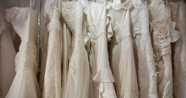 Wedding dresses spend most of their lifespan like this, hanging up