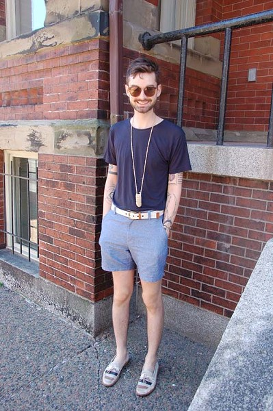 We're not in the habit of chasing men down Barrington Street, but we made an exception for Colby. It wasn't a surprise to learn he has a big collection of accessories; love the pairing of the white belt with the knotted neckpiece and those striped casual loafers. Colby's intricate tattoos demonstrate how ink can work as personal style, too.