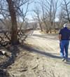 Alex Mills walks along the bed of the Santa Cruz River.
