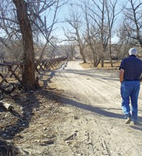 LEO W. BANKS - Alex Mills walks along the bed of the Santa Cruz River.