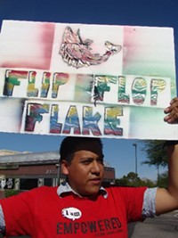 MARI HERRERAS - DREAMer Josue Saldivar protests at Jeff Flake's Tucson campaign office.