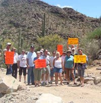 MARI HERRERAS - Forget these angry neighbors fighting for public-access roads; the economy could be Saguaro Ranch developer Stephen Phinny's worst nightmare.
