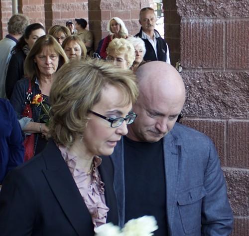Gabby Giffords and Mark Kelly placed a wreath of flowers at a memorial for those slain on Jan. 8, 2011