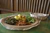 Individual combination with <i>selata, tikil gomen, gomen</i> and  <i>kaye doro</i>, and a side of <i>injera</i> at Café Desta.