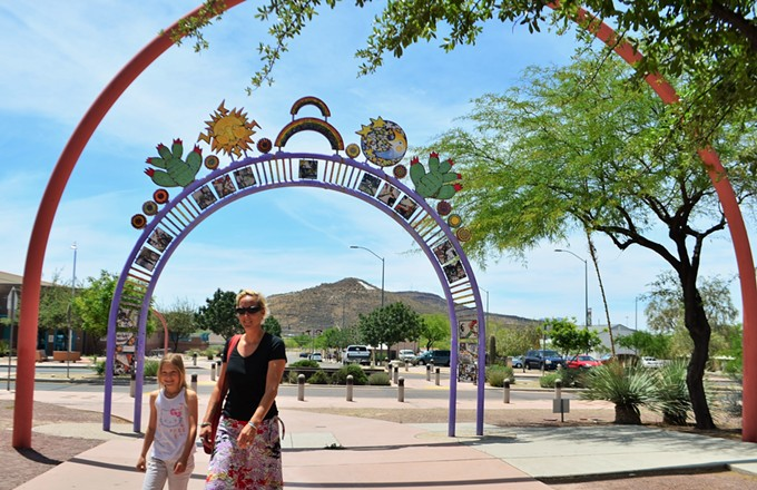 Katharina Fritzche and her daughter Nina walk through Santa Rosa's distinctive arches.