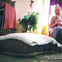 The Story of Mac & Jill Macdonald and her Chihuahua, Haley, check out the dog bed that Macdonald purchased for Mac. Obstacles, such as obtaining consent from her landlord to have the dog, and uncertainty about bringing Mac to Macdonald's workplace, delayed Mac's move-in date. Zachary Vito