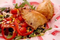Hot empanadas are served with two sides. - HEATHER HOCH