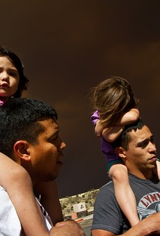 Nick Torres, 31, and his brother Carlos Torres, 29, gaze at the thick smoke that blankets their homes in Springerville with their daughters, Amaya and Hannah, sitting on their shoulders. Nick and Carlos left Springerville on Tuesday, June 7, moments after the official evacuation order for Springerville and Eager was in effect. The evacuation notice was lifted on June 12.