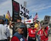 """No on Prop 200 volunteers Caitlin Jensen and Murray Hudson (holding the sign) were met by two women at the Oct. 10 Tucson Tea Party who followed them through the ballpark, shouting, """"ACORN coming through."""""""