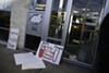 Protesters occupy Mitt Romney's headquarters in Des Moines, Iowa on Wednesday December 28, 2011.