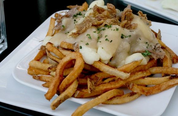 The poutine comes with duck gravy, duck confit and cracklins. - HEATHER HOCH
