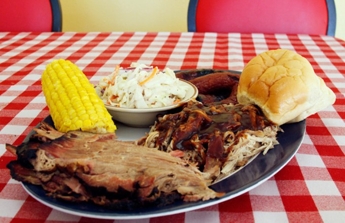 The three-meat combo with cole slaw, corn on the cob and a roll at R&R Bar-B-Que Company.