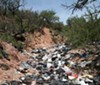 This trash-filled wash is below Diablito Mountain, about 5 miles west of Interstate 19, southwest of Arivaca Junction. It is 21 miles north of the border at Nogales. The illegal aliens who dump their trash here have just emerged from the Tumacacori Highlands, which are also trashed out.