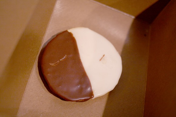 Treat yourself with this black and white cookie. - HEATHER HOCH