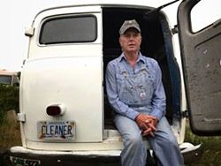 Griffin in one of his vintage trucks. - BRIAN SMITH