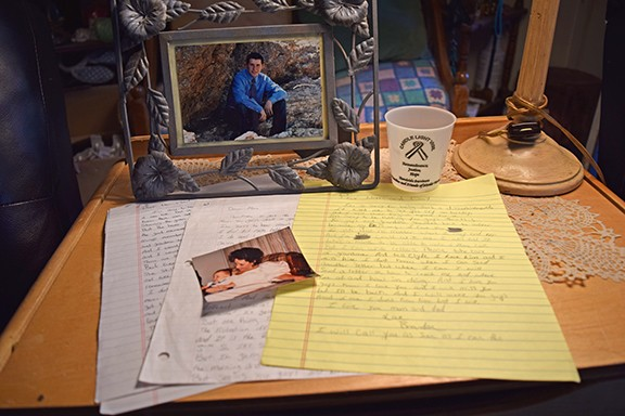 Carrie Walker's son was murdered in Pima County Jail. She remembers him through his letters and photos. - DANYELLE KHMARA