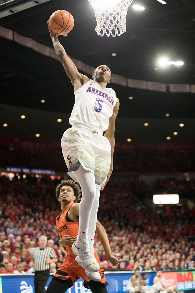 Freshman forward Brandon Randolph throws down a dunk against the University of Oregon on Jan. 13. - STAN LIU | ARIZONA ATHLETICS