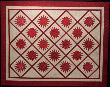 Star Light, Star Bright, the award-winning 2018 raffle quilt for the 2018 Quilt Fiesta, made in honor of the 40th anniversary of the fiesta.