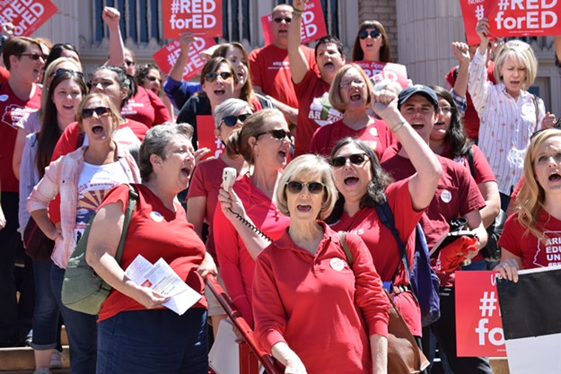 Tucson Magnet High educators rally in front of the downtown high school on Saturday, April 14. - DANYELLE KHMARA