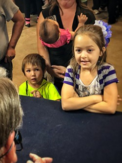 Some enraptured kids at the County Fair. - BRIAN SMITH