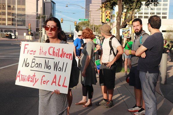 Tucsonans protested across the street from the U.S. District Courthouse. - DALAL RADWAN