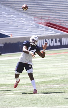 Arizona junior Khalil Tate leads the Wildcats through practice on Tuesday, Aug. 7. - CHRISTOPHER BOAN