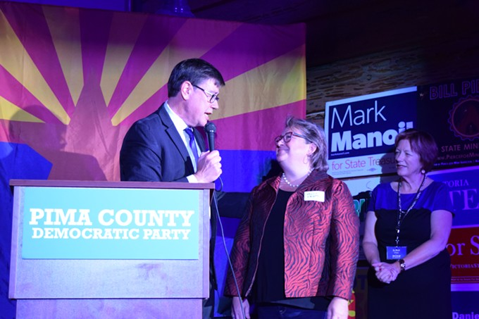 Gubernatorial candidate Steve Farley calls for unity as one of his primary opponents Kelly Fryer takes the stage with him. - DANYELLE KHMARA