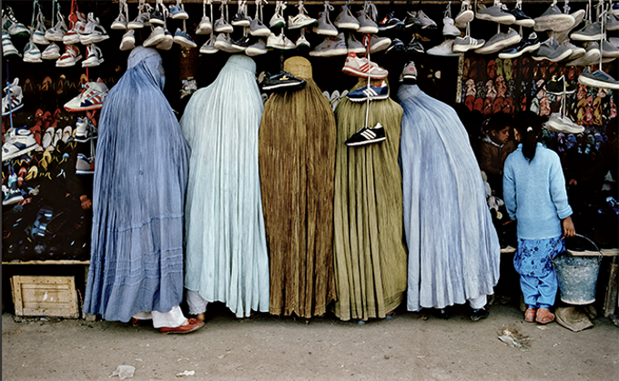 """Afghan Women at Shoe Store,"" Kabul, 1992, by Steve McCurry, whose work will be on display at Etherton Gallery from Sept. 7 though Nov. 10. - COURTESY PHOTO"