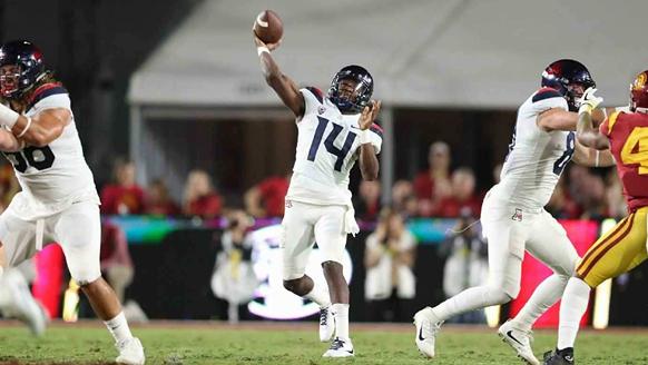 Arizona sophomore quarterback Khalil Tate goes deep with a pass against USC during the Wildcats 49-35 loss last season. - STAN LIU | ARIZONA ATHLETICS